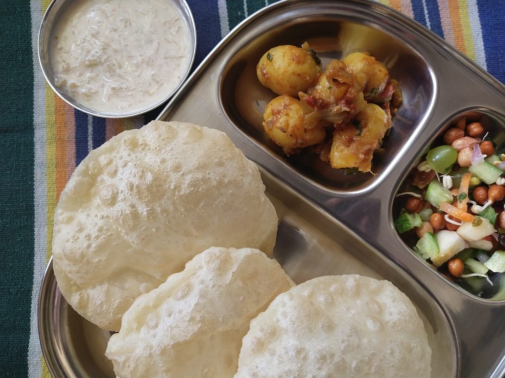 Bengali Luchi is just like our pooris but with a twist. These yummy fried delicacies ( yes I said it - delicacies) are made with maida